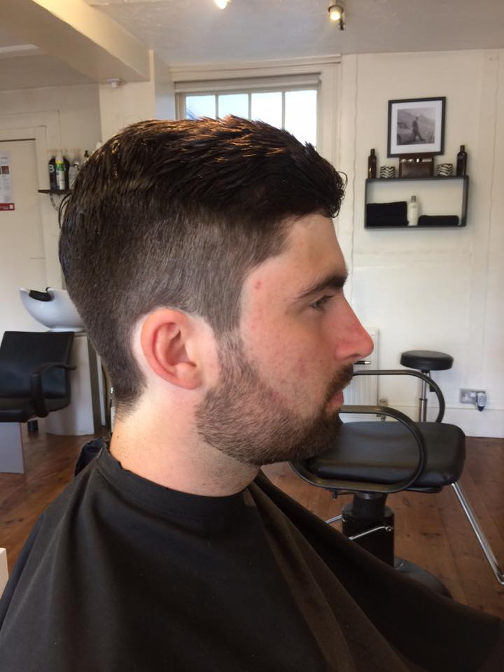 man in barbers shop chair having style